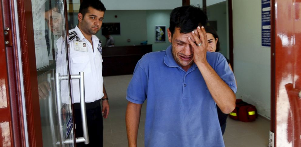 PHOTO: Abdullah Kurdi, father of three-year old Aylan Kurdi, cries as he leaves a morgue in Mugla, Turkey, Sept. 3, 2015.