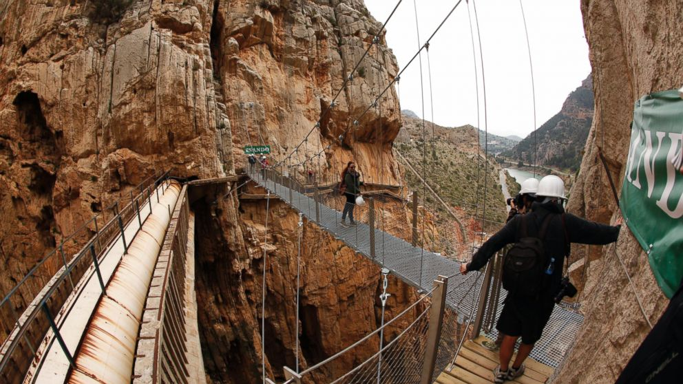 PHOTO: Journalists take pictures as they walk along the new Caminito del Rey (The Kings Little Pathway) in El Chorro-Alora, near Malaga, southern Spain March 15, 2015.