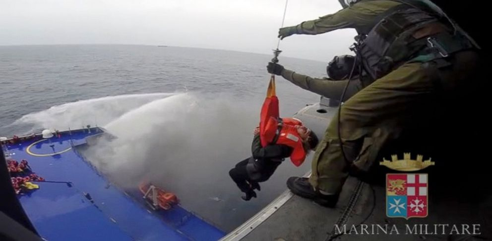 PHOTO: A person is lifted on an Italian Navy helicopter as the car ferry Norman Atlantic burns in waters off Greece, Dec. 28, 2014, in this handout video grab of the Italian Marina Militare.