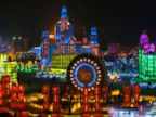 PHOTO: People visit ice sculptures illuminated by colored lights during a trial operation ahead of the Harbin International Ice and Snow Festival in the northern city of Harbin, China, Jan. 4, 2015.
