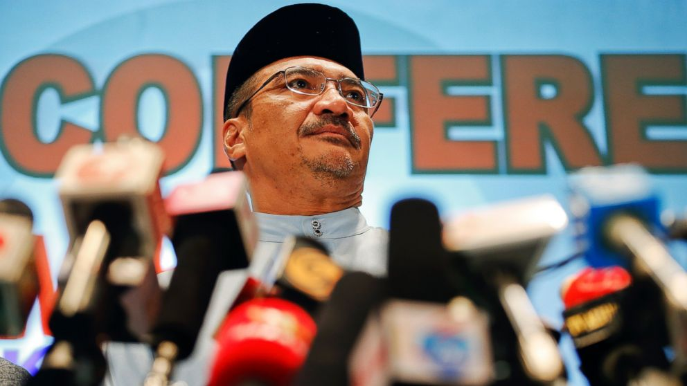 PHOTO: Malaysian Transport Minister Hishammuddin Hussein listens to reporters questions about the missing Malaysia Airlines flight MH370, at Kuala Lumpur International Airport March 21, 2014.