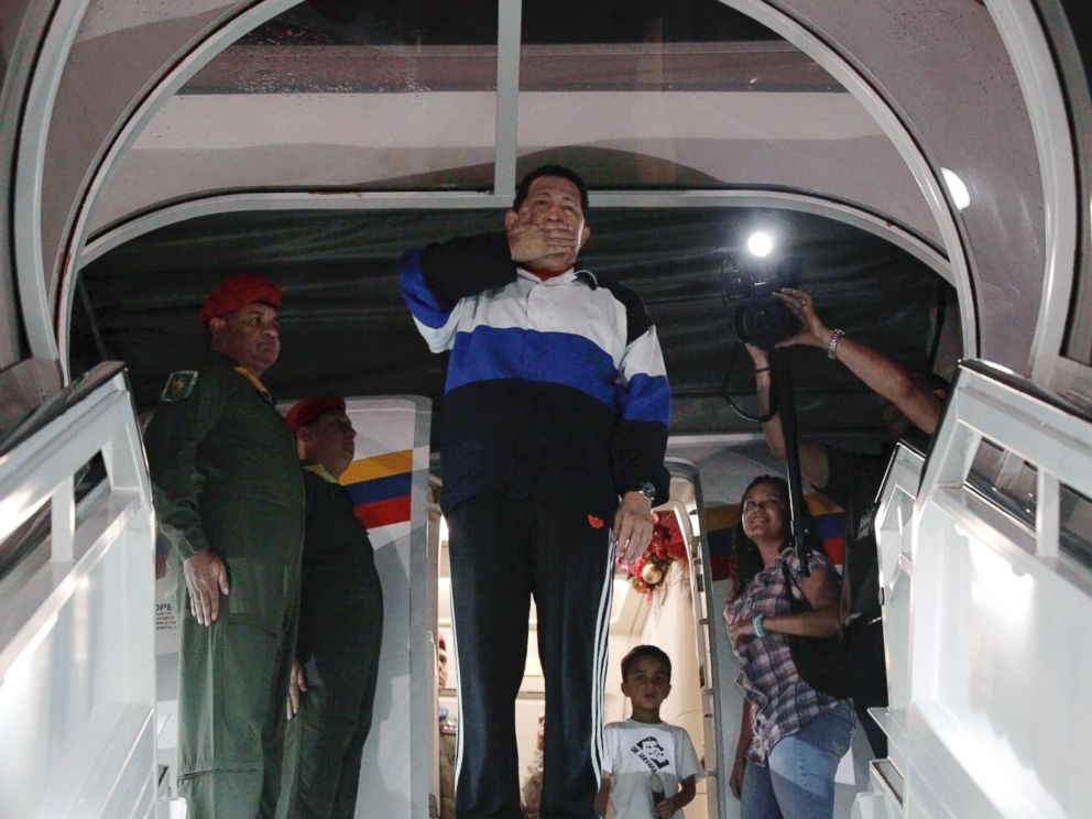 PHOTO: Venezuelan President Hugo Chavez blows a kiss from the door of the airplane before departing to Cuba at Simon Bolivar airport in Caracas, Dec. 10, 2012.