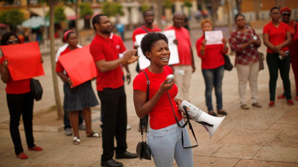 PHOTO: Nigerians take part in a protest for the release of the abducted secondary school girls from the remote village of Chibok in Nigeria, at La Merced square in Malaga, May 13, 2014.