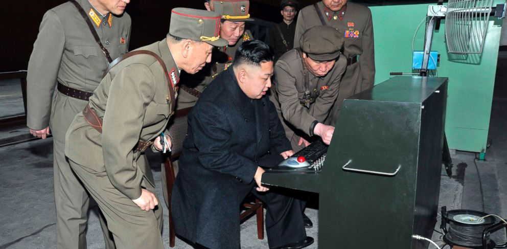 PHOTO: Kim Jong-un looks at the latest combat and technical equipment, made by unit 1501 of the Korean Peoples Army, in this photo released on March 25, 2013.