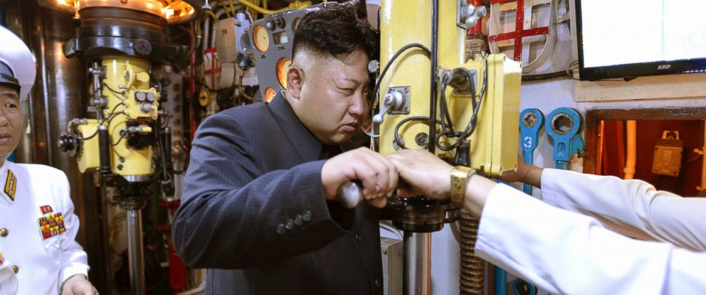 PHOTO: North Korean leader Kim Jong Un looks through a periscope of a submarine during his inspection of the Korean Peoples Army (KPA) Naval Unit 167 in this undated photo released by North Koreas Korean Central News Agency in Pyongyang, June 16, 2014.