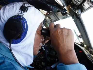 PHOTO: Deputy Commander of Vietnam 918 Air Brigade Senior Lt. Nguyen Tri Thuc looks for the missing Malaysia Airlines flight MH370, March 12, 2014, that disappeared from radar screens off Con Dao island.
