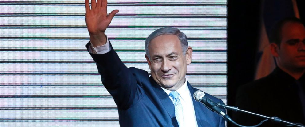 PHOTO: Israeli Prime Minister Benjamin Netanyahu gestures to supporters at party headquarters in Tel Aviv, March 18, 2015.