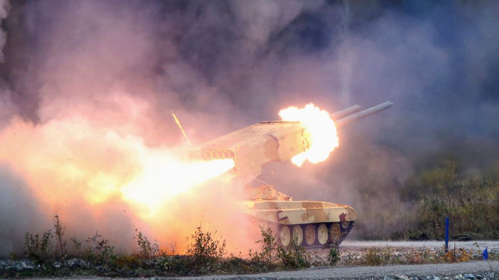 "PHOTO: A Russian ""TOS-1 Buratino"" multiple rocket launcher fires during the ""Russia Arms Expo 2013"" 9th international exhibition of arms, military equipment and ammunition, in the Urals city of Nizhny Tagil, Sept. 25, 2013."