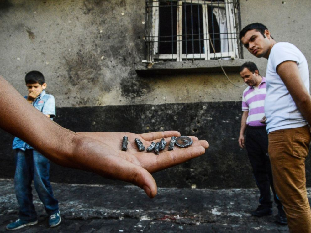 PHOTO: A person shows pieces of projectile near the explosion scene following a late night attack on a wedding party that left at least 30 dead in Gaziantep in southeastern Turkey near the Syrian border, Aug. 21, 2016.
