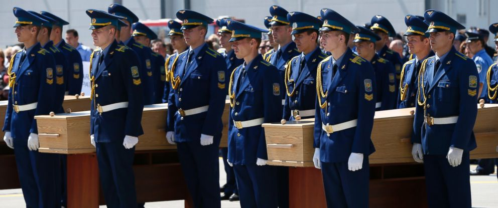 PHOTO: Honor guard members participate in a memorial ceremony for the victims of Malaysia Airlines Flight MH17 at Ukraine's Kharkiv airport, July 23, 2014.