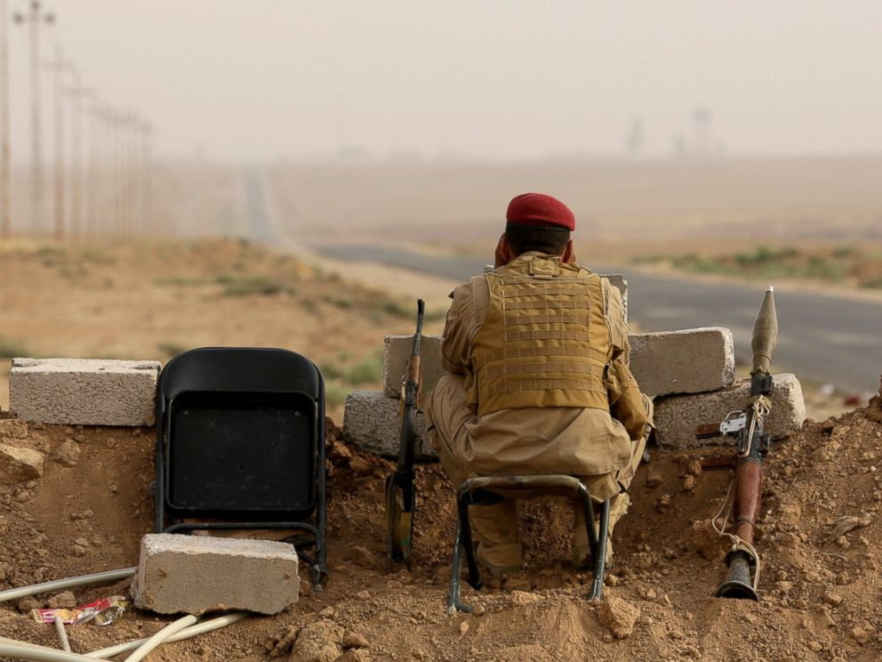 PHOTO: A Kurdish fighter keeps guard while near Mosul in northern Iraq, Aug. 19, 2014.