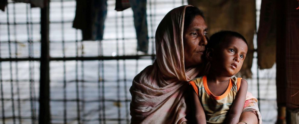 PHOTO: A Rohingya refugee woman waits for aid with her grandson inside their temporary shelter at a camp in Coxs Bazar, Bangladesh, Sept. 19, 2017.