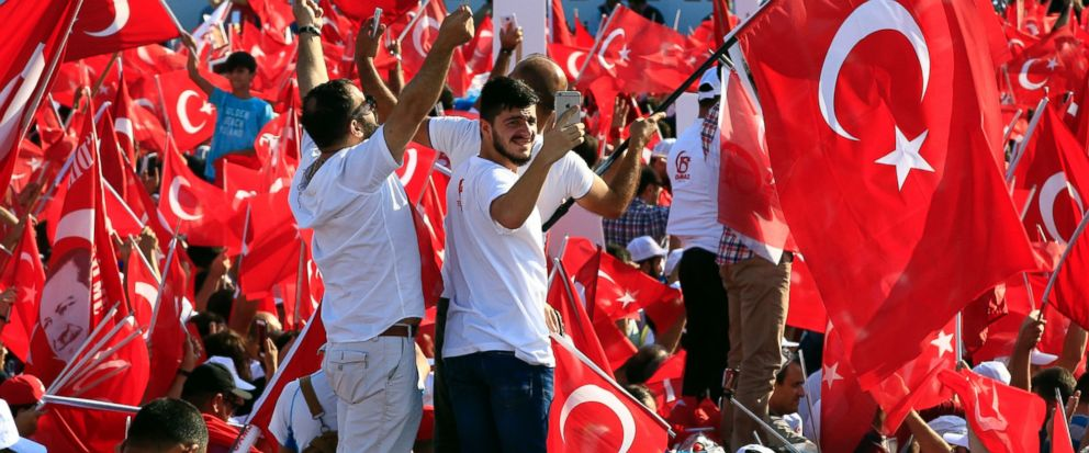 "People take part in the ""National Unity March"" to commemorate the one year anniversary of the July 15, 2016 botched coup attempt, in Istanbul, Saturday, July 15, 2017. Turkey commemorates the first anniversary of the July 15 failed military attempt t"