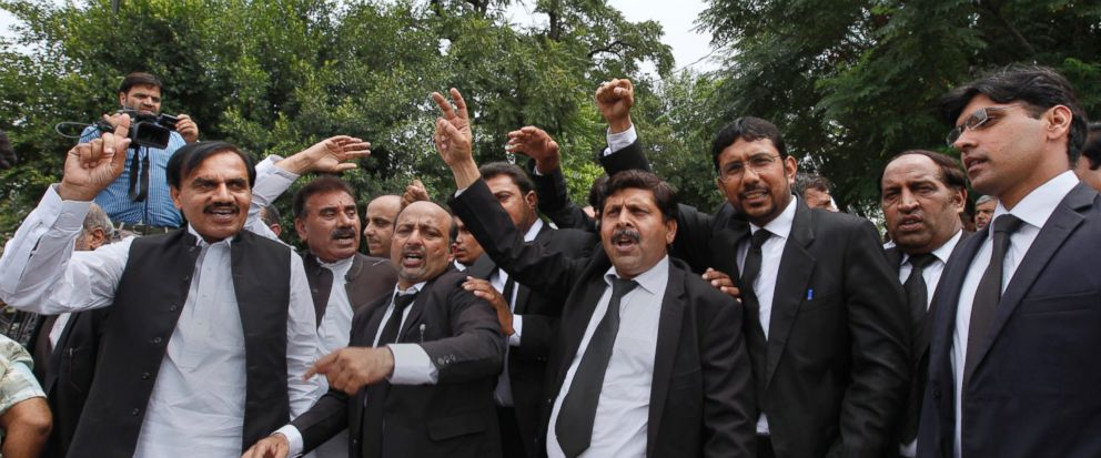 """Lawyers shout """"go Nawaz go"""" after leaving the Supreme Court following proceedings on corruption allegations case against Prime Minister Nawaz Sharifs family, in Islamabad, Pakistan, Monday, July 17, 2017. The lawyers for opposition parties requested"""