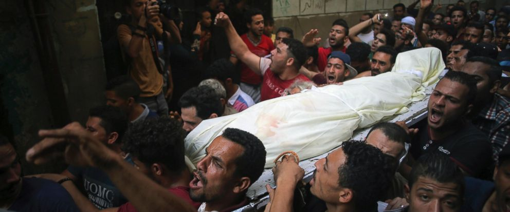People carry the body of Sayed Tafshan, who died during clashes between security forces and residents of al-Waraq island, on the southern fringes of Cairo, Egypt, Sunday, July 16, 2017. Egypts Health Ministry said one person was killed and 19 injure