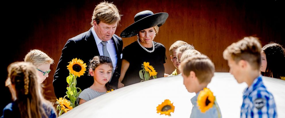 Dutch King Willem-Alexander, center left, and Queen Maxima during the revealing of the National Monument for the MH17 victims in Vijfhuizen, The Netherlands, Monday, July 17, 2017. Relatives and friends of people killed 3 years ago when a surface-to-