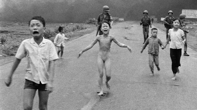PHOTO: Crying children, including 9-year-old Kim Phuc, center, run down Route 1 near Trang Bang, Vietnam after an aerial napalm attack on suspected Viet Cong hiding places as South Vietnamese forces from the 25th Division walk behind them, June 8, 1972.