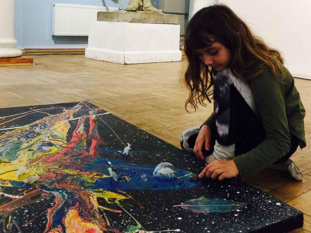 PHOTO: Aelita Andre pictured at the Russian Academy of Fine Arts Museum putting the final touches on her Music of the Infinite exhibit.