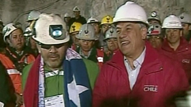 VIDEO: Crowds join President Sebastian Pinera in song as the final miner is rescued.