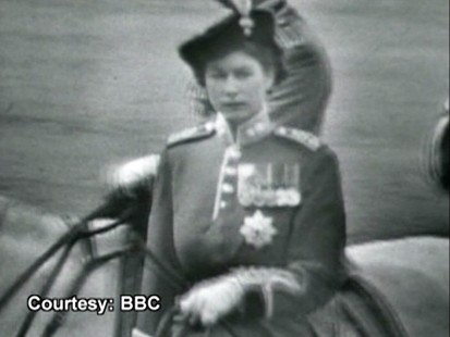 VIDEO: Queen Elizabeth stands in for her father at a military parade.
