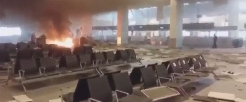 PHOTO: A video shot inside the Brussels Airport shows the departure terminal seconds after the explosion.