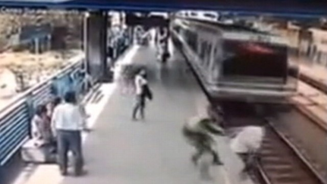 Video: Cops Last-Second Grab Saves Man from Speeding Train