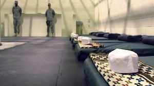PHOTO A communal cell with prayer rugs, caps and sleeping mats at the detention facility at Parwan, Afghanistan, is shown, Nov. 15, 2009.