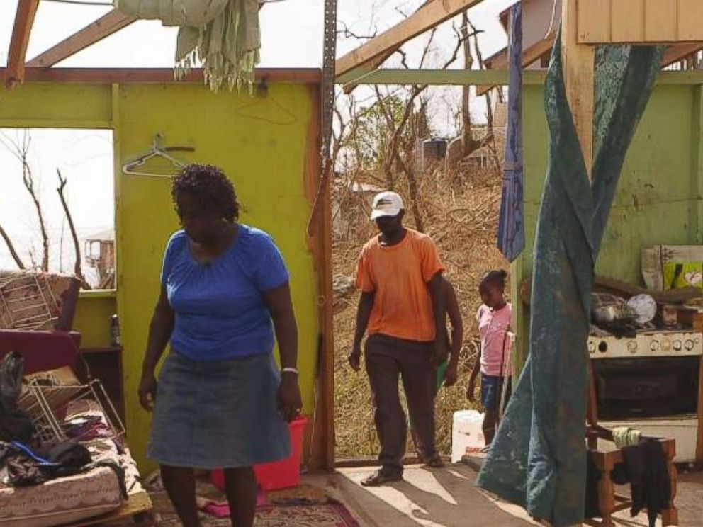 Verlyn Peter picked her way through the wreckage of her home in Dominica after Hurricane Maria.