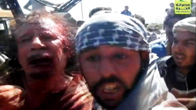 VIDEO: Video appears to show the bloodied Libyan dictator surrounded by rebel forces.