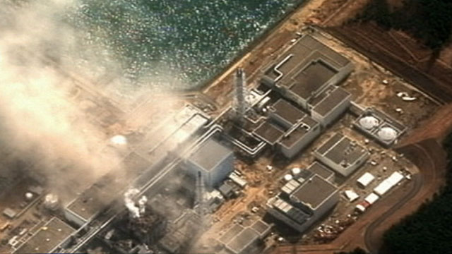 PHOTO Work to stabilize the damaged reactors at the Fukushima Daiichi nuclear power plant was temporarily halted because radiation leaking from the units made the situation