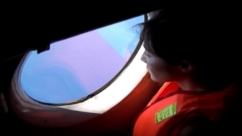 VIDEO: Vietnamese military cargo plane searches for missing Malaysian jetliner.