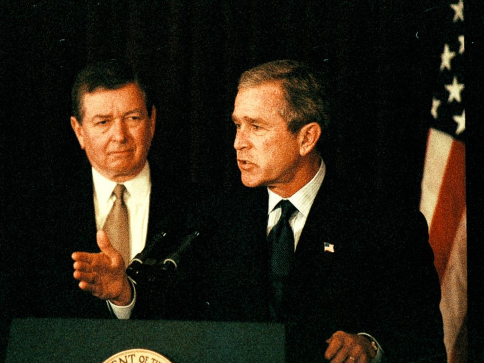 PHOTO: Flanked by then-U.S. Attorney General John Ashcroft, President George W. Bush announces the FBIs first Most Wanted Terrorist list at FBI headquarters on Oct. 10, 2001.