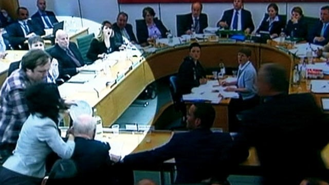 PHOTO: Rupert Murdoch is attacked at the Culture, Media and Sport Select Committee hearing on the News of the World phone-hacking scandal, July 19, 2011.