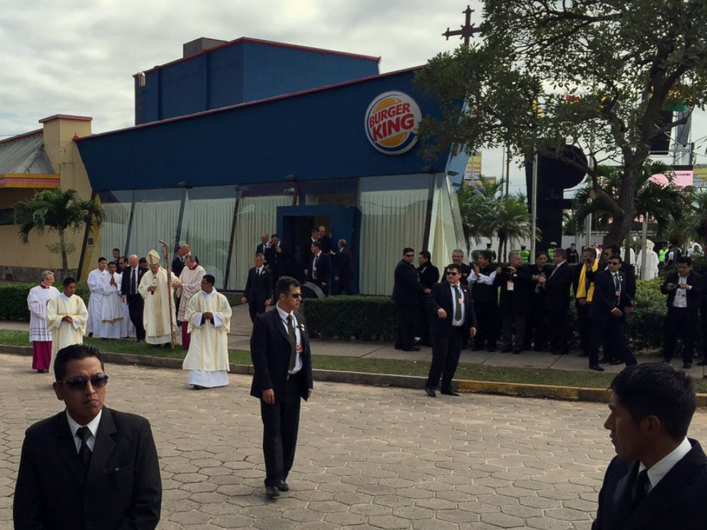 PHOTO: Pope Francis stands outside the Burger King franchise that served as a makeshift sacristy for open air mass in Santa Cruz, Bolivia, July 9, 2015.