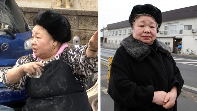 PHOTO: 72-year-old Saki Hoshi describes the height of the tsunami waters, to ABC's Diane Sawyer on March 14, 2011.