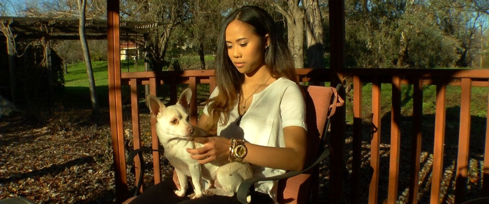 "Sokha Chan, 22, is shown here with her dog during an interview with ABC News ""Nightline."""