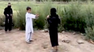 PHOTO A screengrab shown here from a disturbing video of children acting out a suicide bomb mission