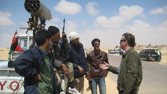 PHOTO Terry Moran spoke with a group of rebel soldiers at a staging area ten miles outside of Ajdabiya as they waited for orders to move on April 9, 2011.