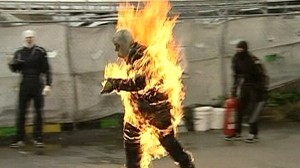 Man on fire running