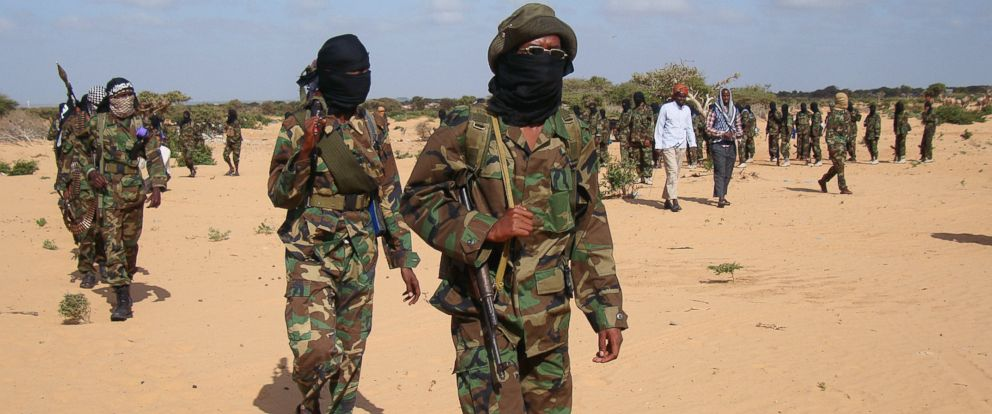 PHOTO: A file photo showing Somali Al-Shebab fighters as they gathered on Feb. 13, 2012 in Elasha Biyaha, after a demonstration to support the merger of Al-shebab and the Al-Qaeda network.