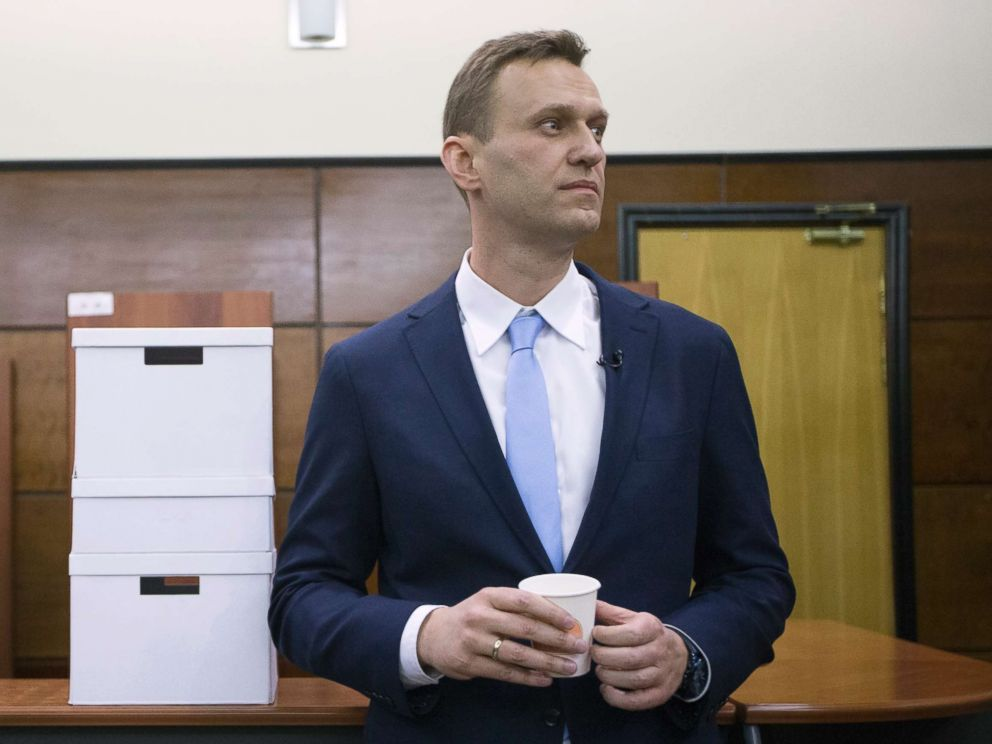 PHOTO: Russian opposition leader Alexei Navalny rests next to boxes with endorsement papers in support of his presidential bid to Russias Central Election in Moscow, Dec. 24, 2017.
