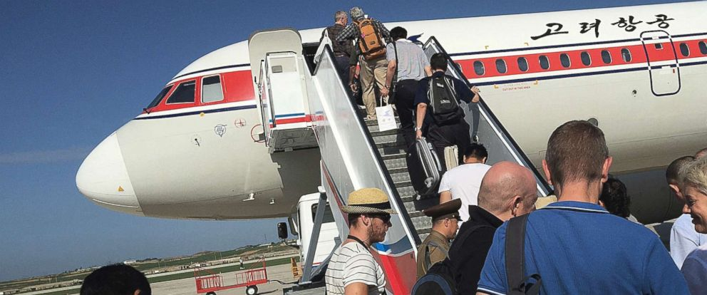 PHOTO: Passengers board an Air Koryo plane bound for Beijing, at the Pyongyang International Airport in Pyongyang, North Korea, June 27, 2015.
