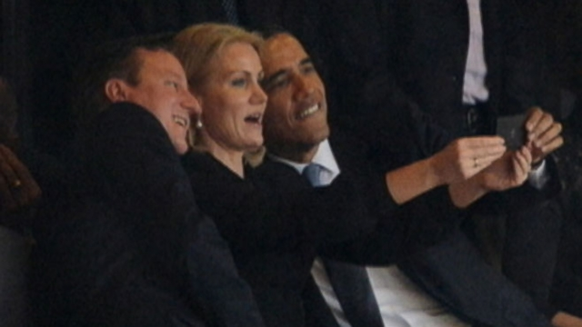 Helle Thorning-Schmidt defends posing with British PM David Cameron and President Barack Obama.
