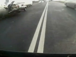 Watch: Caught on Tape: Driver Survives Collision With Truck