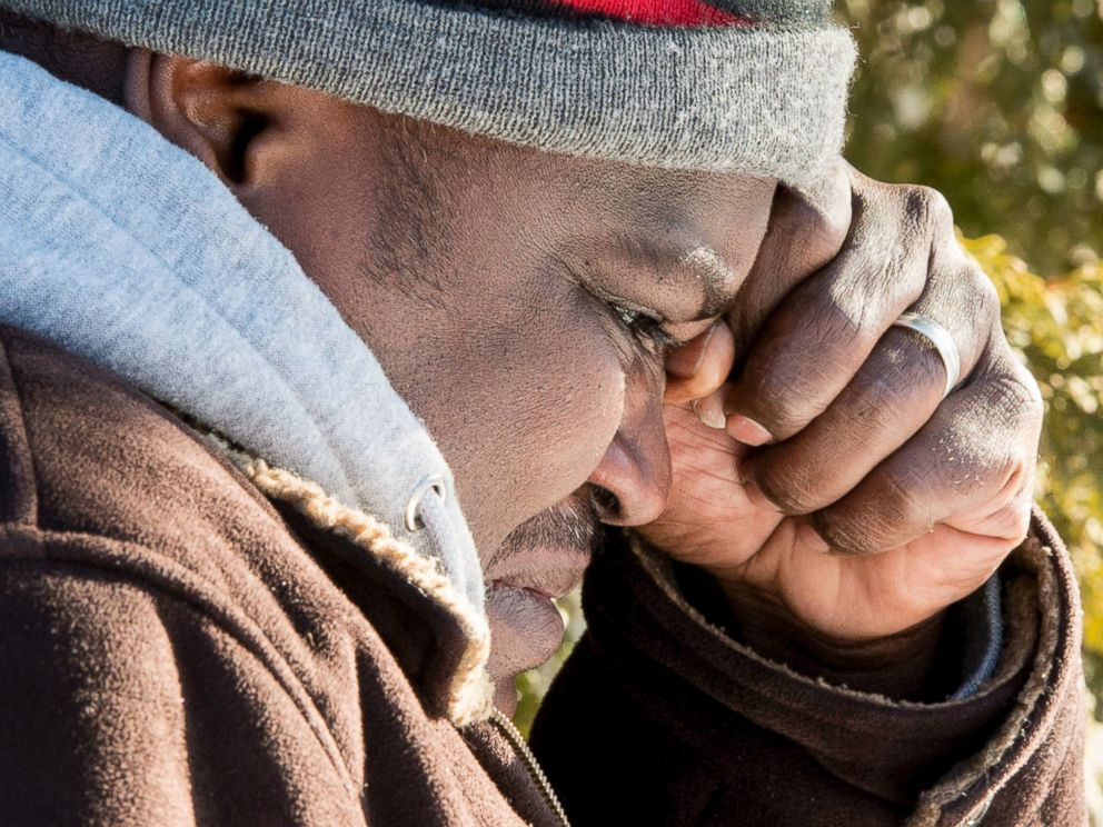 PHOTO: A Somali man wipes a tear after crossing the U.S.-Canada border into Canada near Hemmingford, Que., on Feb. 17, 2017.