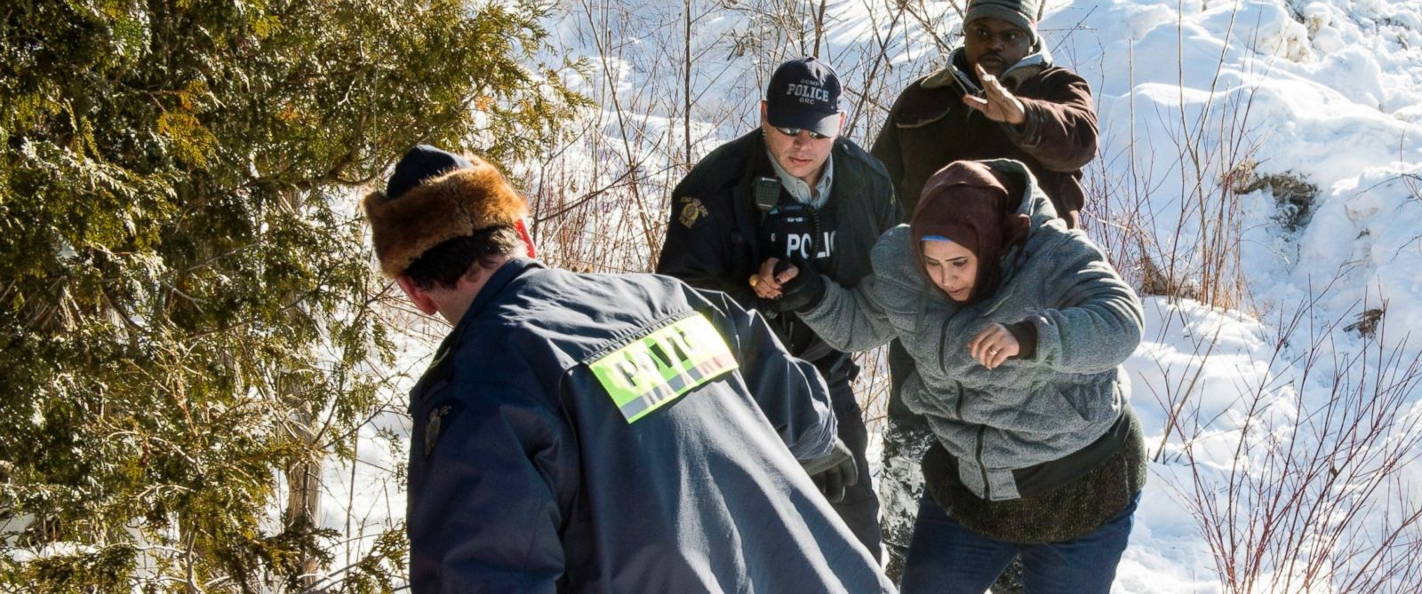 PHOTO: A pregnant woman from Somalia is escorted by Royal Canadian Mounted Police officers after crossing the U.S.-Canada border near Hemmingford, Quebec on Feb. 17, 2017.