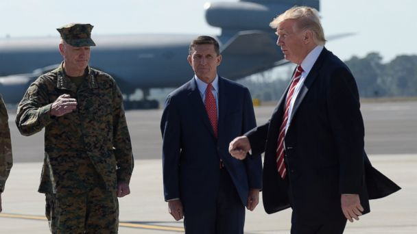 PHOTO: President Donald Trump passed Joint Chiefs Chairman Gen. Joseph Dunford, left, and National Security Adviser Michael Flynn as he arrives via Air Force One at MacDill Air Force Base in Tampa, Florida, Feb. 6, 2017.