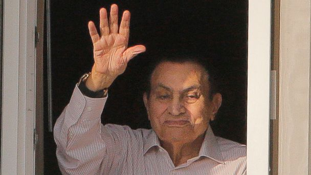 PHOTO: In this Oct. 6, 2016 file photo, ousted Egyptian President Hosni Mubarak waves to his supporters from his room at the Maadi Military Hospital. Mubarak returned home on Friday, March 24, 2017, following his release from custody.