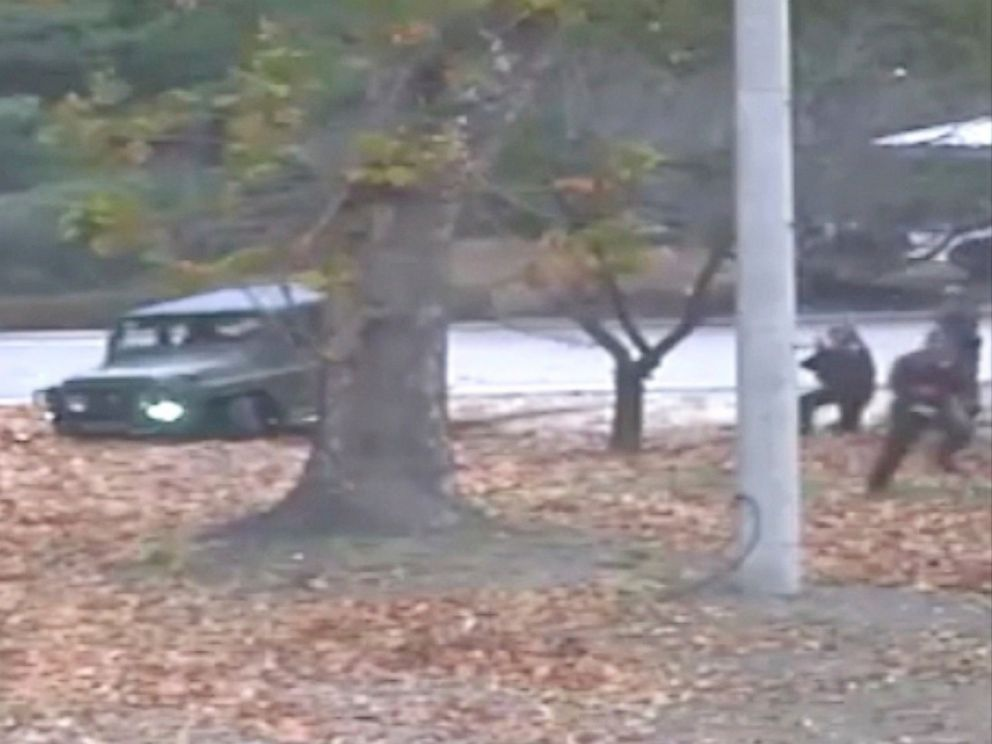 This image made from Nov. 13, 2017 surveillance video released by the United Nations Command shows a North Korean soldier running from a jeep and later shot by North Korean soldiers in Panmunjom, North Korea.