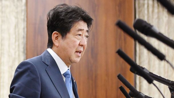 PHOTO: Japanese Prime Minister Shinzo Abe speaks in front of a line of microphones at a parliamentary panel on national security and diplomacy at parliament's upper house in Tokyo, April 13, 2017.